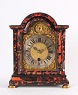 An attractive South German small red tortoishell and ebonized bracket timepiece with automaton, circa 1740.