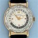 Fine and scarce Asassiz world time vintage 14K yellow gold wrist watch
